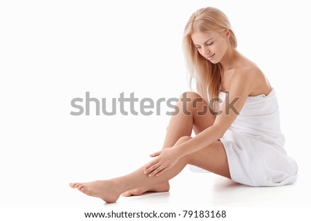 A beautiful young girl on a white background - stock photo