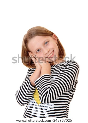 A beautiful young girl standing for white background with her hands together on her face and smiling.  - stock photo