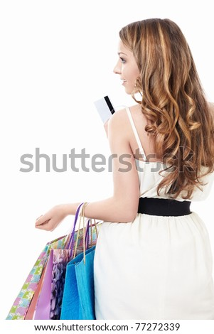A beautiful young girl with bags and credit card is isolated - stock photo