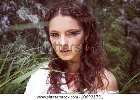a beautiful young girl with creative make-up, - stock photo