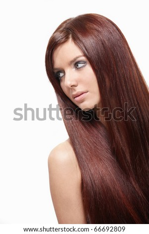 A beautiful young girl with long hair on a white background