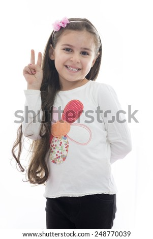 A Beautiful Young Girl with Victory Hand Sign Isolated on White background - stock photo