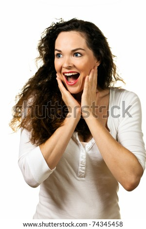 A beautiful young happy woman looking pleasantly surprised - stock photo