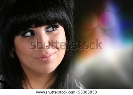 A beautiful young Hispanic woman with a smile on her face. - stock photo