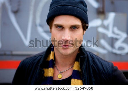 A beautiful young man with a cap and a scarf