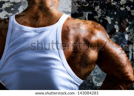 A beautiful young muscular man's shoulder. Laying on the body camouflage texture