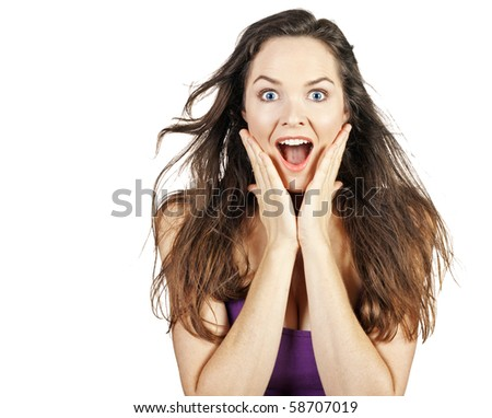 A beautiful young surprised woman. Isolated over white.