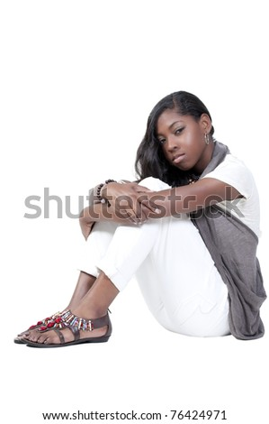 A beautiful young teenage African American woman suffering from the mental illness of depression - stock photo