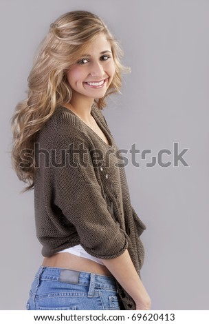 a beautiful young teenage girl with pretty long blond hair.