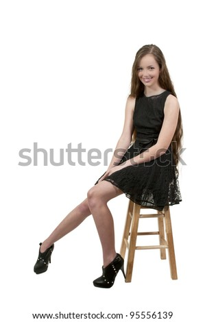 A beautiful young teenage woman looking far away - stock photo