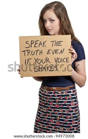 A beautiful young teenaged woman holding up a sign - stock photo