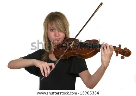 A beautiful young teenager playing her violin - stock photo