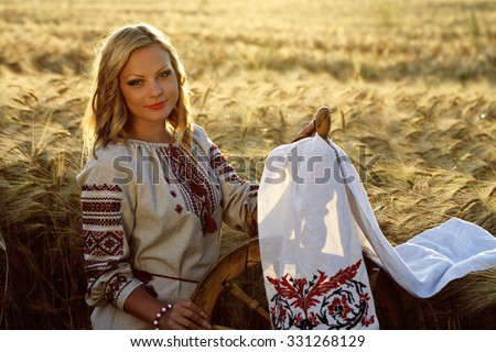 a beautiful young Ukrainian girl in traditional dress with embroidered