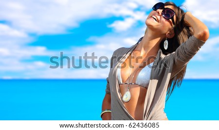 A beautiful young woman at the beach in Greece - stock photo