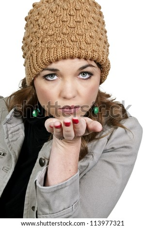 A beautiful young woman blowing a kiss - stock photo