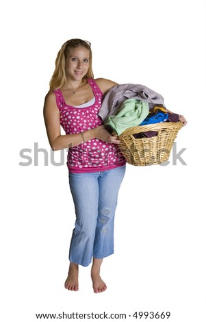 A beautiful young woman doing laundry - stock photo