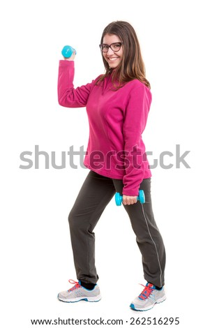 A beautiful young woman exercising - fitness concept - stock photo