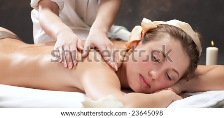 A beautiful young woman getting a massage