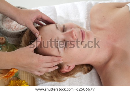 A beautiful young woman getting a massage in wellness centre