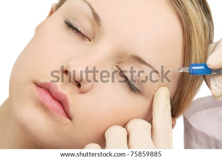 A beautiful young woman having injection - stock photo