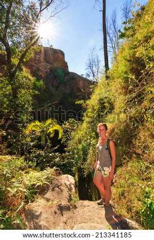 A beautiful young woman hiking in the beautiful canyons of Isalo national park, Madagascar - stock photo