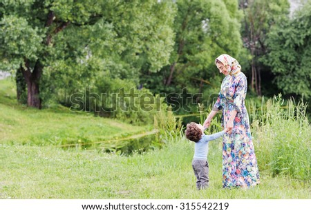 a beautiful young woman holding hands kid pretty and cute smiles