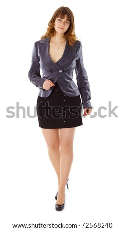 A beautiful young woman in a business suit isolated on white background - stock photo