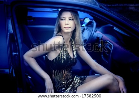 a beautiful young woman in a car - stock photo