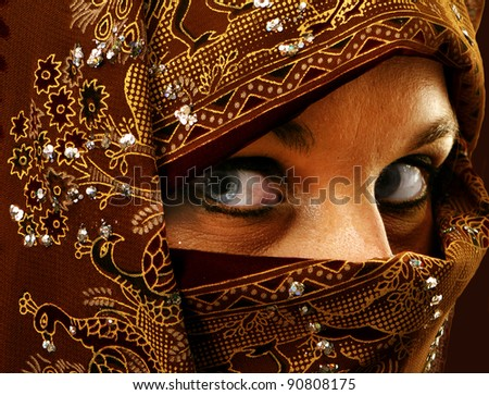 A beautiful young woman in headress, - stock photo