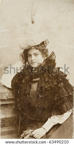 A beautiful young woman, old photos - stock photo