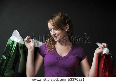 A beautiful young woman on a shopping spree - stock photo