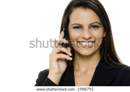 A beautiful young woman on the phone on white background