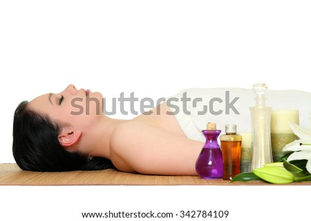 A beautiful young woman relaxing. Spa on a white background