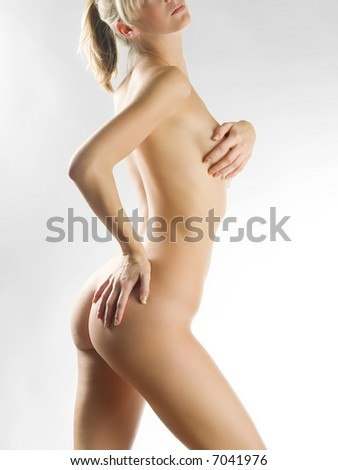 a beautiful young woman showing her naked body - stock photo