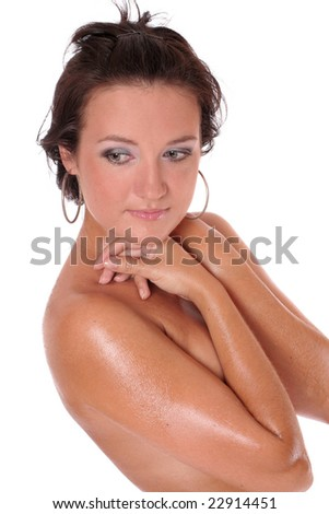 A beautiful young woman standing topless over white background - stock photo
