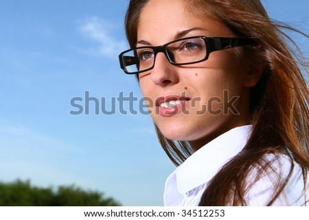 a beautiful young woman studing