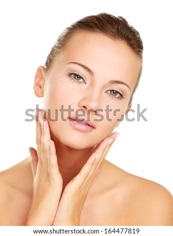 A beautiful young woman touching her face, isolated on white, closeup - stock photo
