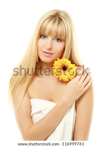 A beautiful young woman with a flower, isolated on white - stock photo