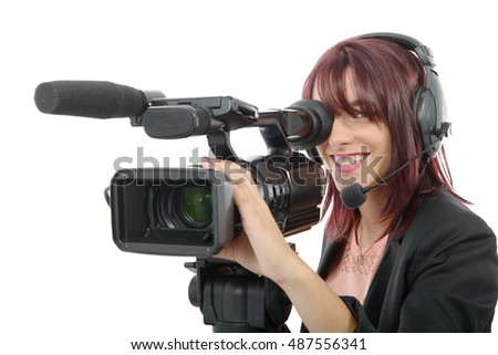 a beautiful young woman with a professional video camera and headphone