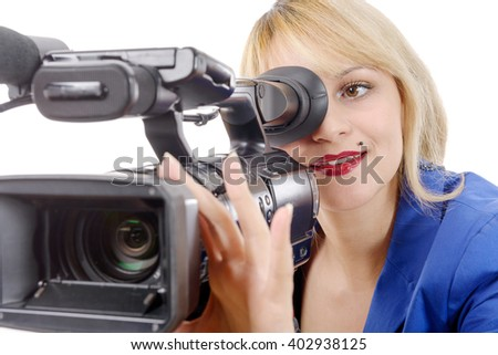 a beautiful young woman with blue suit and professional video camera