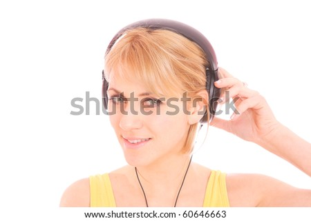 A beautiful young woman with headphones listening music