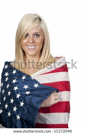 A beautiful young woman wrapped in a flag. - stock photo