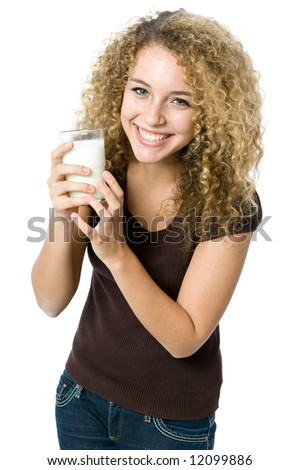 A beautiful young women holding a glass of milk - stock photo