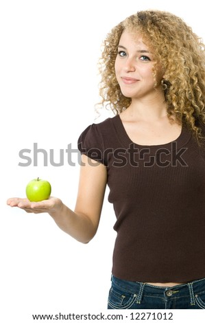 A beautiful young women holding an apple - stock photo