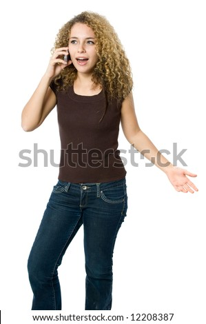 A beautiful young women looking angry and upset on her phone - stock photo