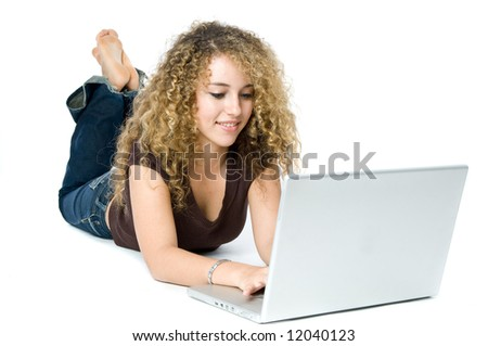 A beautiful young women on a laptop computer - stock photo