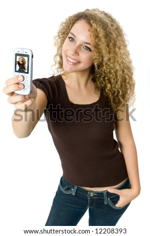 A beautiful young women taking a picture of herself with her mobile - stock photo