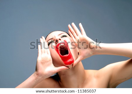 a beauty female with red lips is screaming - stock photo