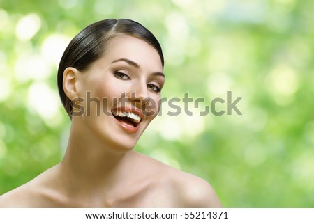 a beauty girl on the green background - stock photo