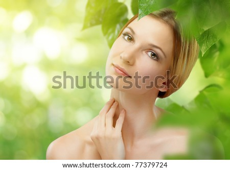a beauty girl on the leaves background - stock photo